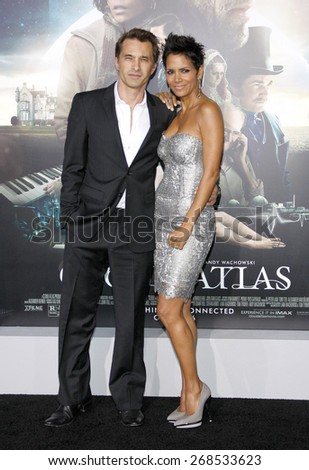 Halle Berry and Olivier Martinez at the Los Angeles premiere of 'Cloud Atlas' held at the Grauman's Chinese Theatre in Hollywood on October 24, 2012.  - stock photo