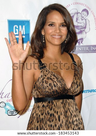 Halle Berry, wearing a Dolce & Gabbana dress, at Jenesse Silver Rose Gala & Auction, Beverly Hills Hotel, Beverly Hills, CA, April 27, 2008  - stock photo