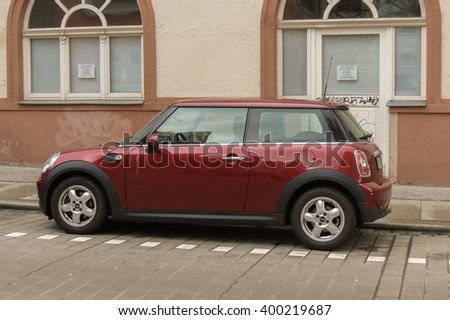 HALLE (SAALE), GERMANY - CIRCA MARCH 2016: dark red or maroon Mini Cooper car - stock photo