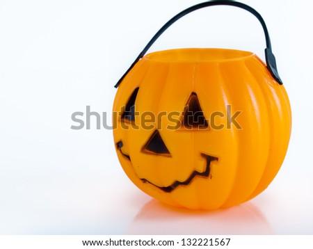 Halloween bag in shape of Jack-o'-lantern on white background. - stock photo
