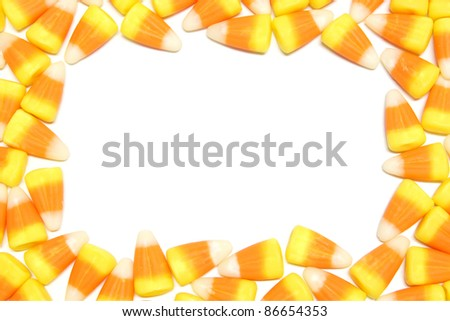 Halloween candy corn frame over white - stock photo