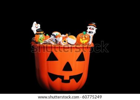 Halloween candy in pumpkin - stock photo