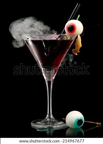 Halloween cocktail with smoke - stock photo