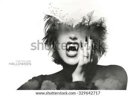 Halloween concept with a Gothic girl with dark clothes and nails wearing vampire teeth with a double exposure of flying bats above an eerie forest over her forehead, isolated on white with sample text - stock photo