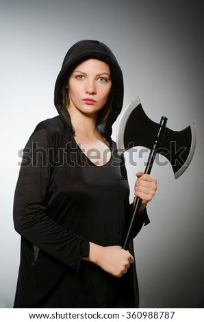 Halloween concept with scary woman - stock photo