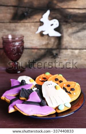 Halloween cookies on black plate - stock photo