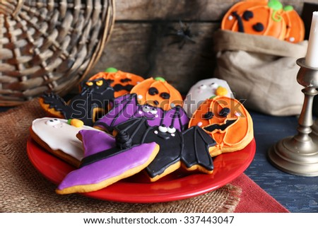 Halloween cookies on red plate - stock photo