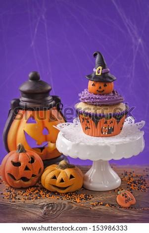 Halloween cupcake and  pumpkin decoration - stock photo