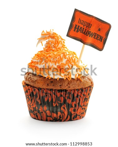 Halloween cupcake with whipped cream and decoration isolated on white - stock photo