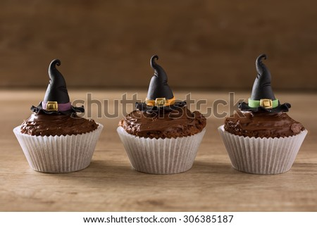 Halloween cupcakes with witch hat background - stock photo