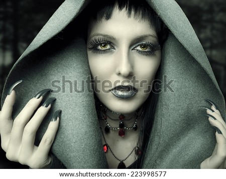 Halloween. Fashion portrait of witch or night vampire woman. Dark gothic makeup - stock photo
