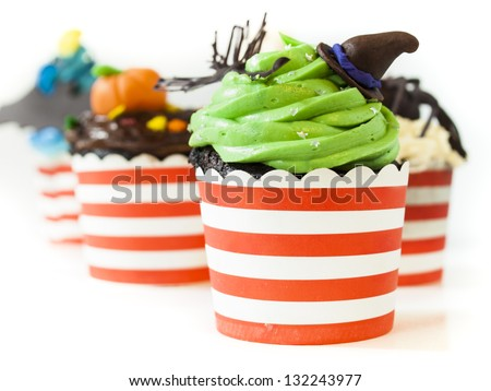 Halloween gourmet cupcakes with holiday decor on white background. - stock photo