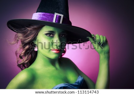 Halloween green witch on a pink background - stock photo