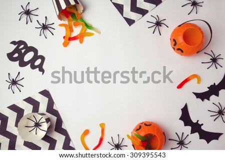Halloween holiday background with spiders and candy. View from above - stock photo