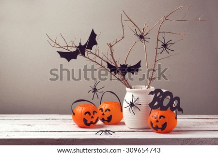 Halloween holiday celebration with spiders and pumpkin buckets for trick or treat. - stock photo