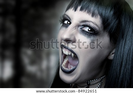Halloween horror concept. Dark portrait of Night mystic woman vampire - stock photo
