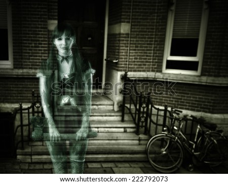 Halloween horror. Scary transparent blurred  woman ghost with ax on porch of house - stock photo