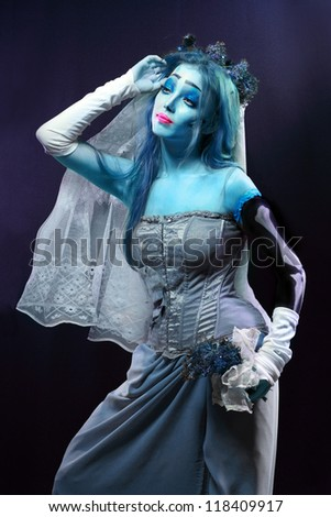 Halloween: Horror scene of a corpse bride under blue moon light - stock photo