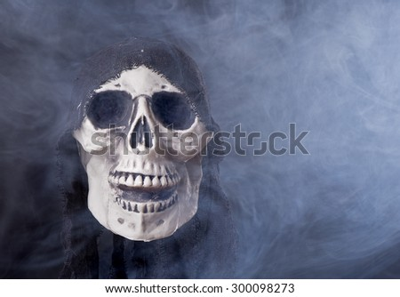 Halloween human skull in a smoky background - stock photo