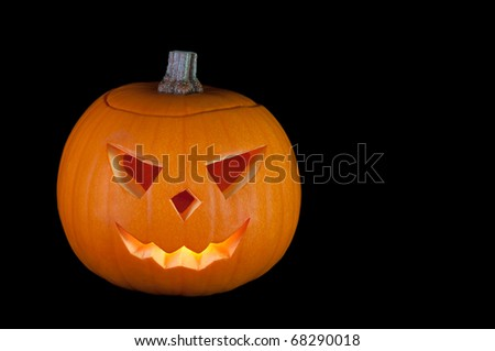 Halloween Jack-o-Lantern carved from pumpkin isolated on black - stock photo