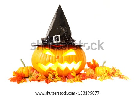 Halloween Jack o Lantern with witch hat and autumn leaves - stock photo