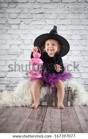 Halloween little girl witch - stock photo