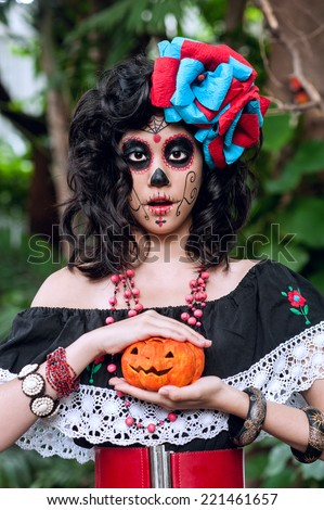 halloween make up sugar skull beautiful model with perfect hairstyle. Santa Muerte concept. - stock photo