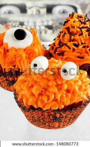Halloween monster cupcakes - stock photo