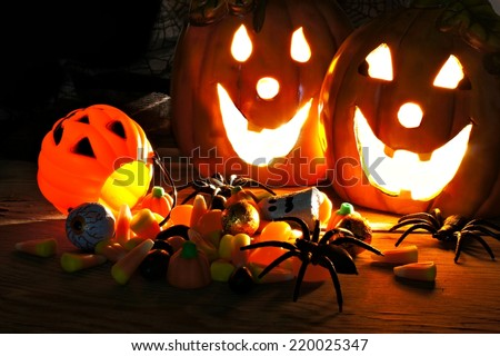 Halloween night scene with Jack o Lanterns and candy - stock photo
