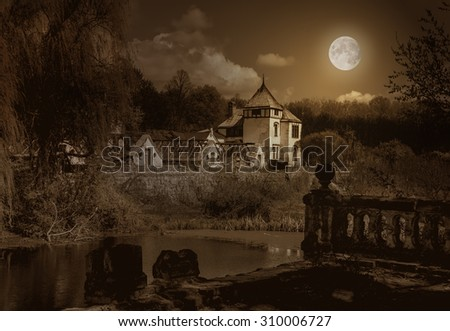 Halloween old haunted house and park - stock photo