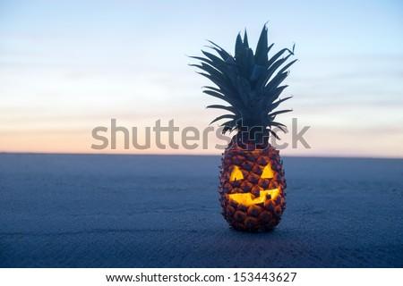 Halloween on Beach. Pineapple jack o lantern - stock photo