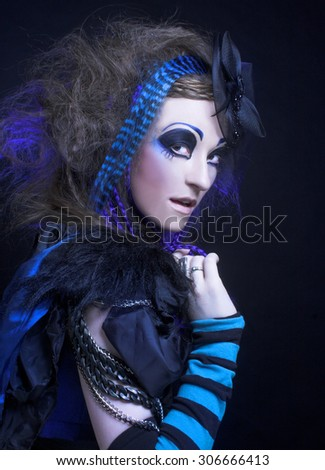 Halloween. Portrait of young woman posing in gothic image. - stock photo