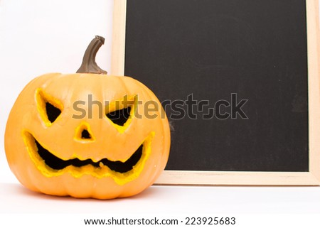 Halloween pumpkin and blackboard - stock photo