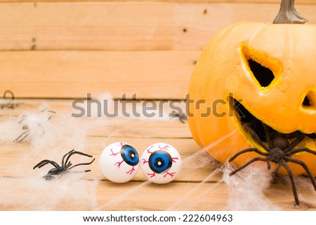 Halloween pumpkin and eyes - stock photo
