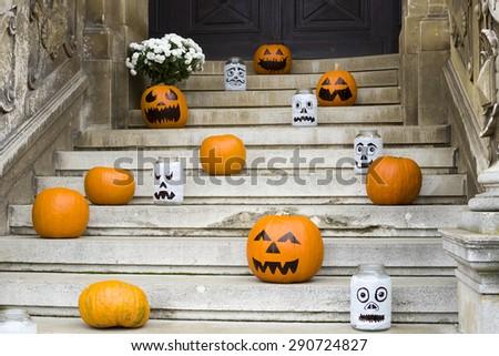 Halloween pumpkin decoration on stone stairs - stock photo