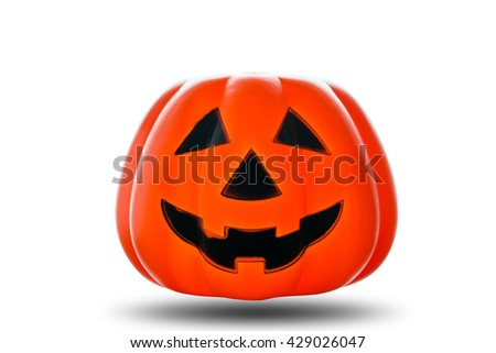 Halloween Pumpkin, funny Jack O Lantern on white background. Halloween Pumpkin made from plastic for decorate Halloween Festival. - stock photo