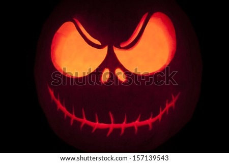 Halloween pumpkin grimming face close up - stock photo
