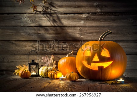 Halloween pumpkin head jack lantern on wooden background - stock photo
