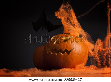 Halloween pumpkin head scary face with evil eye jack spooky and creepy horror lantern - stock photo