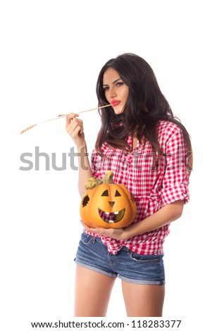 Halloween pumpkin in good hands - Beautiful young woman with a dreamy look holding a smiling Halloween pumpkin on white background - stock photo