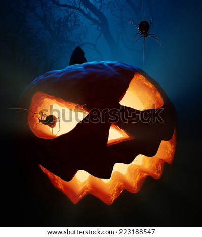 Halloween pumpkin  ( jack o'lantern ) with spiders in the woods - stock photo