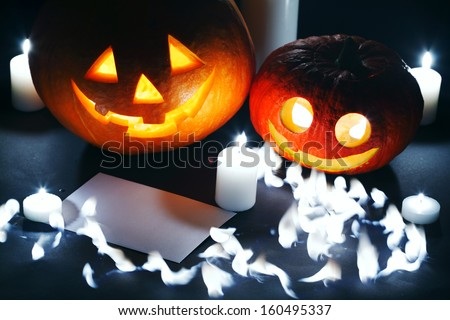 Halloween pumpkin lantern, candles and blank post card - stock photo