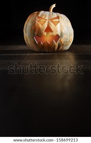 Halloween Pumpkin  lantern in the dark room - stock photo