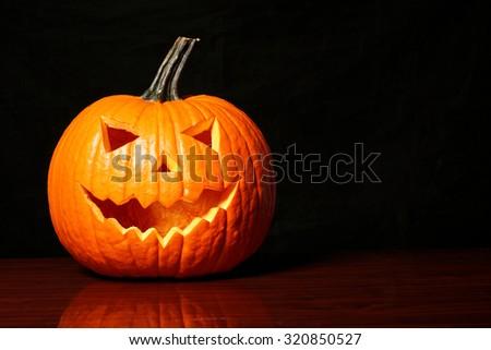 Halloween pumpkin on black background - stock photo