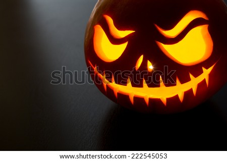 Halloween pumpkin on grey background with copyspace - stock photo