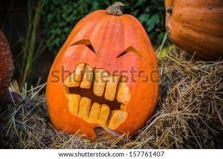 Halloween pumpkin on hay - stock photo