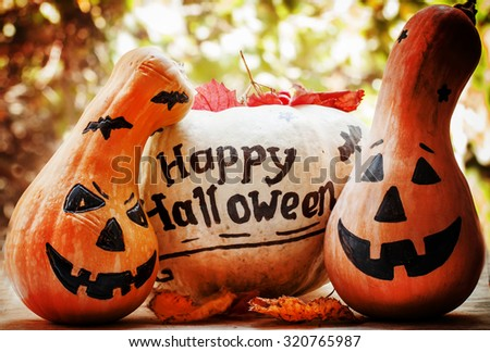Halloween pumpkin on old wooden background, dark toned image, selective focus - stock photo