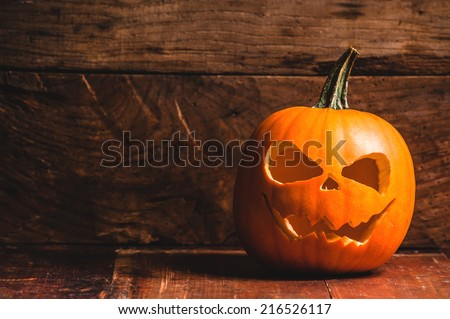 Halloween pumpkin on wooden rustic background - stock photo