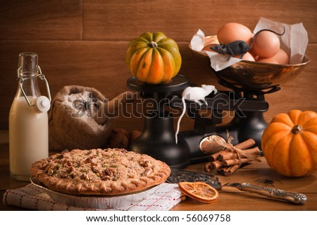 Halloween pumpkin pie with spiders and mice in rustic setting - stock photo