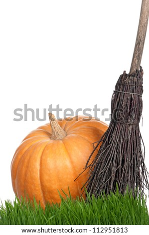 Halloween pumpkin with black hat and broom isolated on white background - stock photo